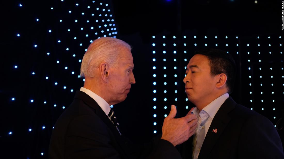Yang and former Vice President Joe Biden talk backstage at the CNN Democratic debates in July 2019.
