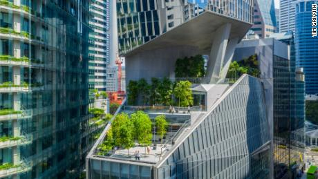 A gravity-defying tower aimed at 'sustainable urbanism' has opened in Singapore