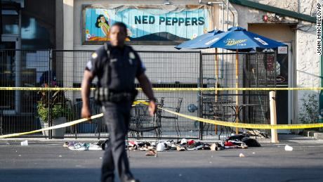Shoes lie scattered outside the scene of the massacre in Dayton, Ohio.