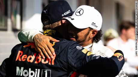 Lewis Hamilton and Max Verstappen embrace following their thrilling battle.