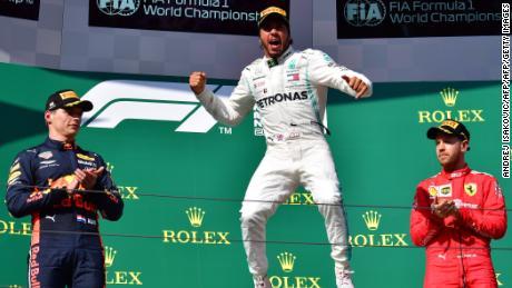 Lewis Hamilton celebrates his seventh Hungarian Grand Prix win.