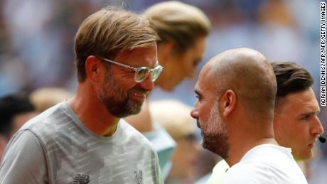 Liverpool manager Jurgen Klopp (L) greets Manchester City's Pep Guardiola (R) before kick off of the English FA Community Shield in August.