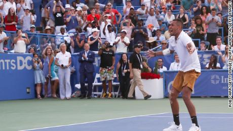 Nick Kyrgios celebrates winning match point against Daniil Medvedev during the men's singles final.