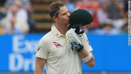 Steve Smith kisses his helmet as he celebrates reaching his century during play on the fourth day.