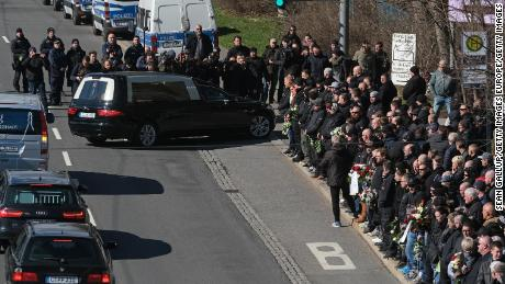 Crowds, many of them members of the Chemnitz football hooligan scene, gather to mourn the death of neo-Nazi leader Tommy Haller.