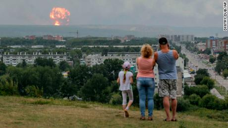 Dozens were injured in a series of explosions at munitions dump in Achinsk.