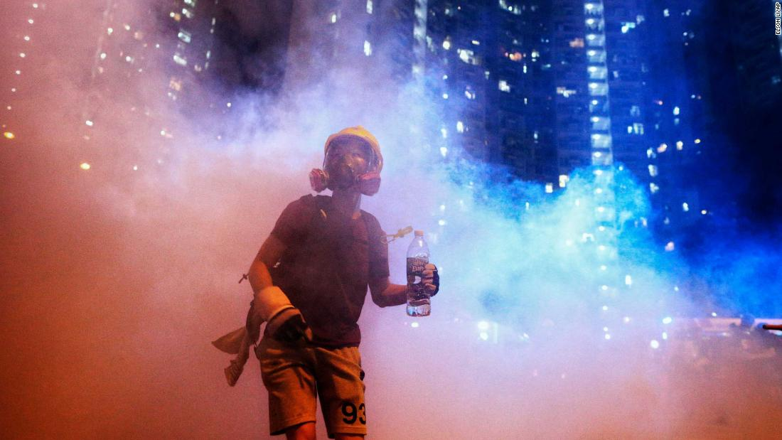 A protester stands in tear gas during a confrontation with police in the early hours of Sunday, August 4.