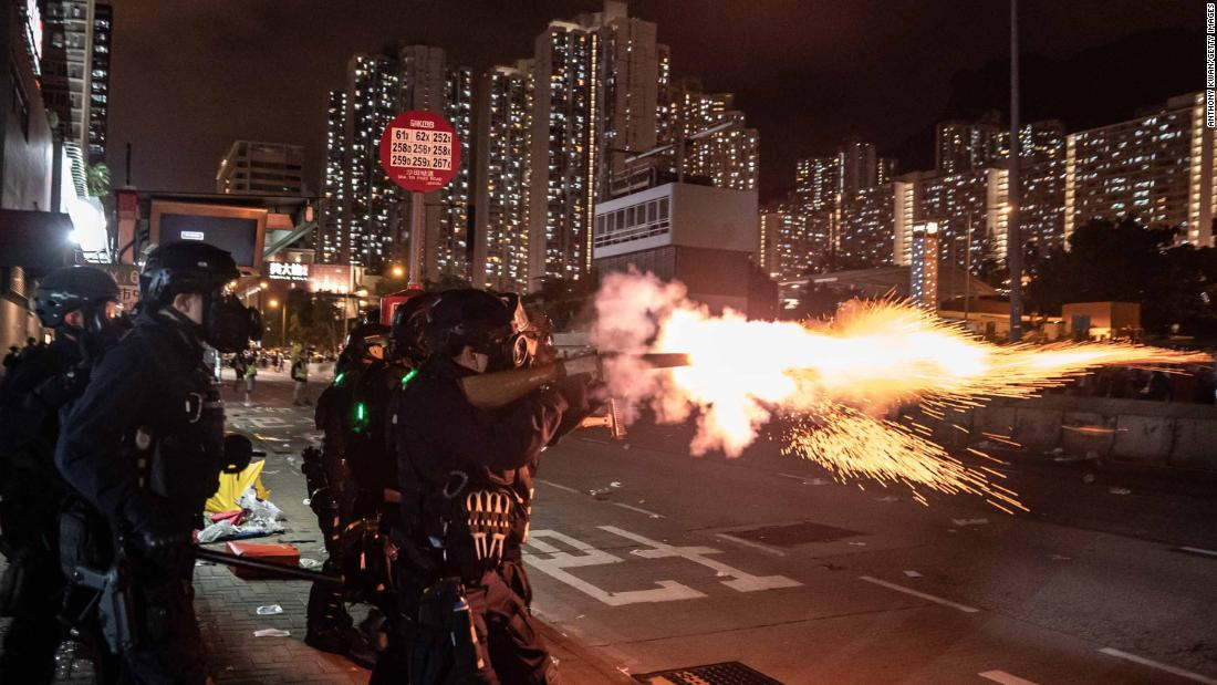 Police fire tear gas at protesters during a demonstration in the Wong Tai Sin District on Monday, August 5.