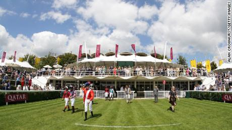 Jockeys leave the weighing room at Goodwood.