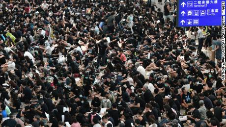 After night of violence, thousands of protesters shut down Hong Kong airport