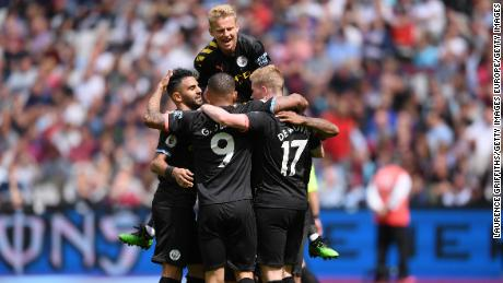 Man City players celebrate Sterling's second goals against West Ham.