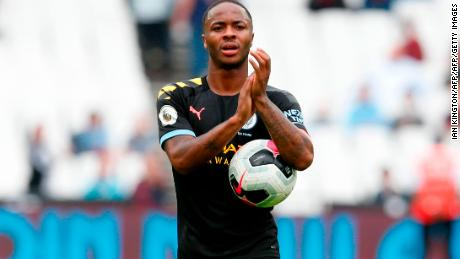 Raheem Sterling takes the match ball after scoring a hat-trick.