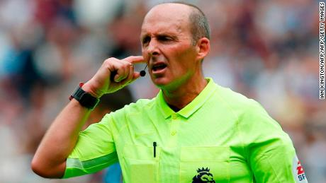Referee Mike Dean consults the video assistant referee