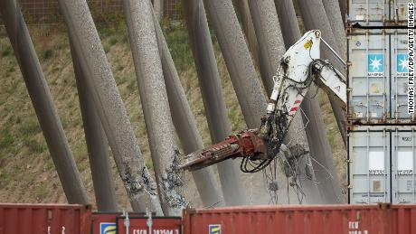 A robot weakens one of the supporting pillars of the cooling tower.