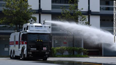 Hong Kong Police demonstrate their new water cannon equipped vehicle at the Police Tactical Unit compound in Hong Kong on August 12, 2019.