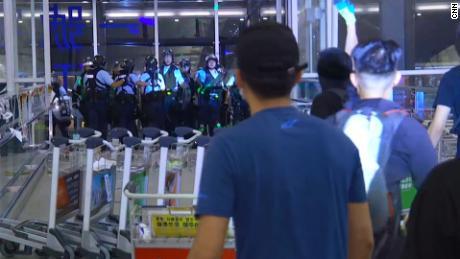 Hong Kong police clash with protesters in chaotic scenes at airport
