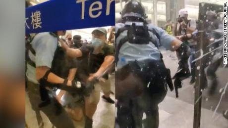 Riot Police Clash With Protesters at Hong Kong Airport