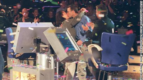 Contestant John Joh John Carpenter (kissing his wife, Debbie) became the first $1 million dollar winner on the show in 1999. (Photo by Maria Melin/Walt Disney Television via Getty Images)