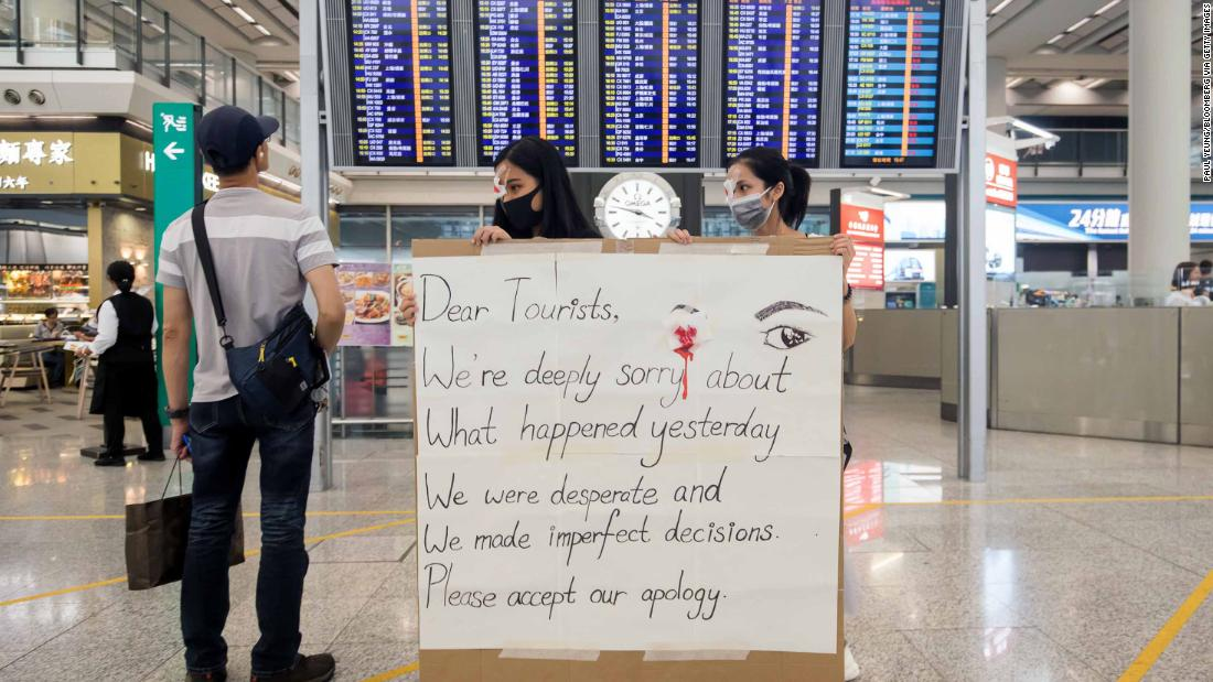 "Two protesters hold up an apology sign at the Hong Kong International Airport, which resumed operations on August 14. For two days, <a href=""https://www.cnn.com/2019/08/13/asia/hong-kong-airport-chaos-intl-hnk/index.html"" target=""_blank"">protesters flooded the airport.</a> Check-ins were suspended and dozens of outgoing flights were canceled."