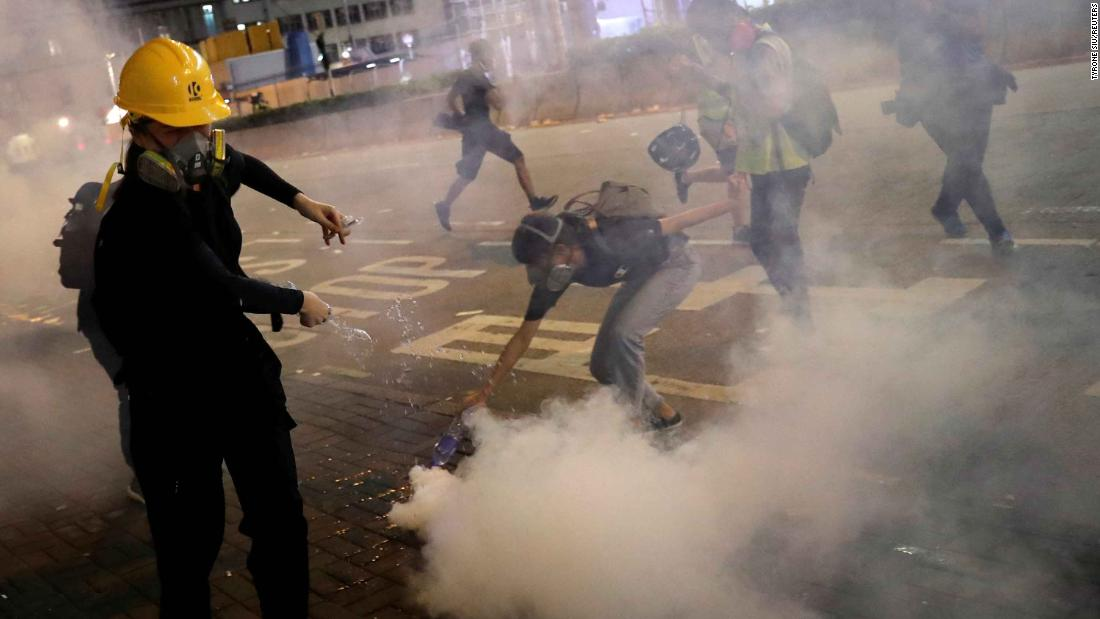 Tear gas envelops demonstrators at Sham Shui Po.