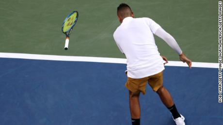 Kyrgios throws his racket during a match against Lorenzo Sonego.
