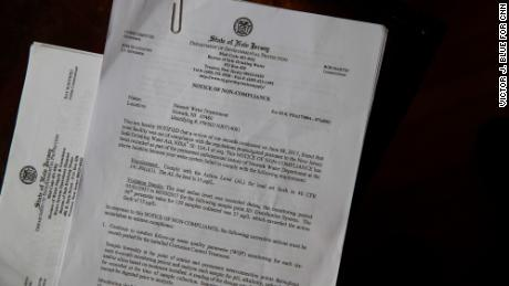 A copy of a state order to the city of Newark sits on a table in Shakima Thomas' home.