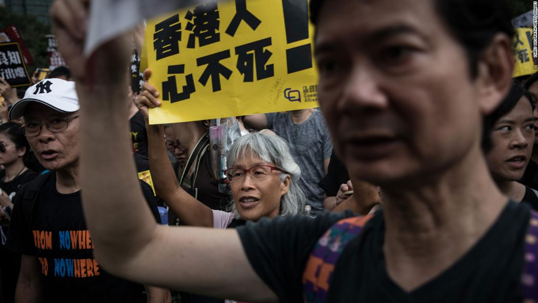 Protesters take part in a rally in Victoria Park on August 18.