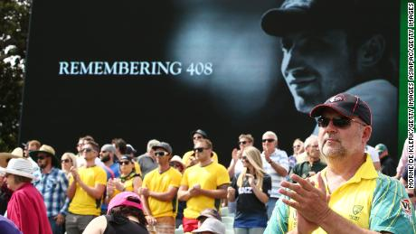Spectators pay tribute to former cricketer Phillip Hughes.