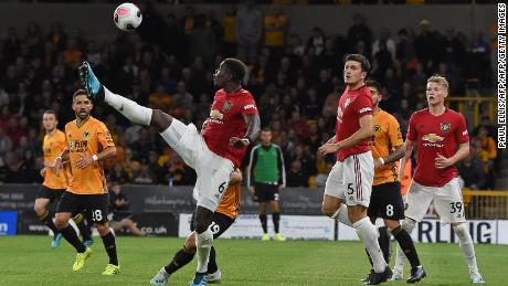 Paul Pogba (C) attempts to control the ball during the English Premier League football match between Wolverhampton Wanderers and Manchester United.