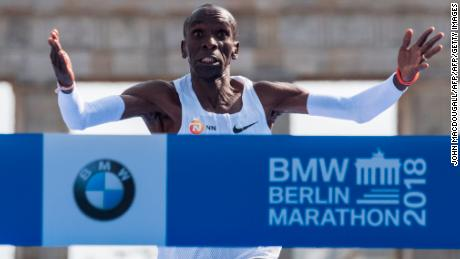 Kipchoge crosses the finish line to win the Berlin Marathon, setting a new world record.