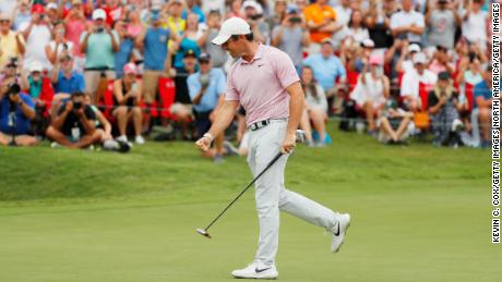 McIlroy celebrates after winning on the 18th green during the Tour Championship.