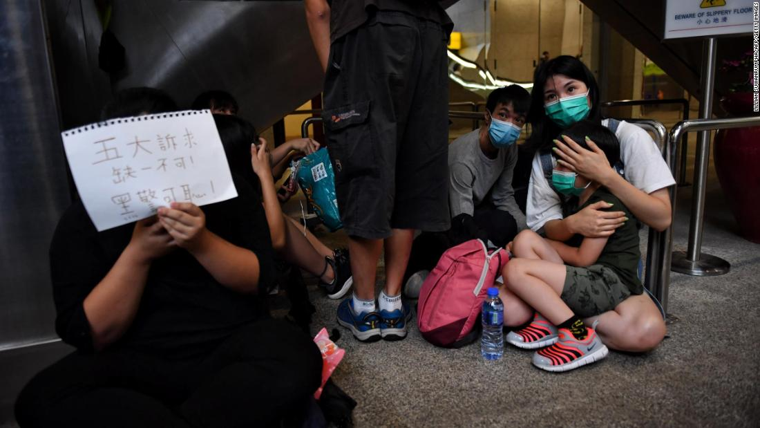 Protesters gather in the lobby of Hong Kong's Revenue Department.