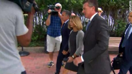 Lori Loughlin and her husband appear at hearing in college admissions scam