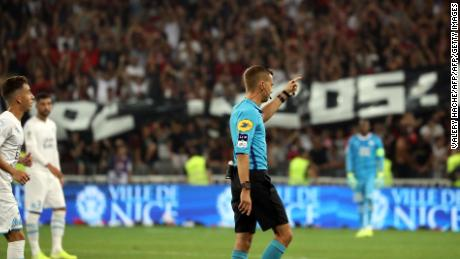 French referee Clement Turpin halts the game in Nice Wednesday.