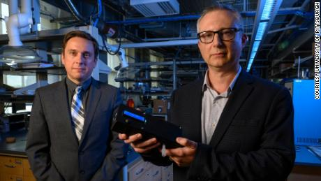 Ervin Sejdic (left) and Alexander Star (right) hold the THC breathalyzer prototype they developed at the University of Pittsburgh.
