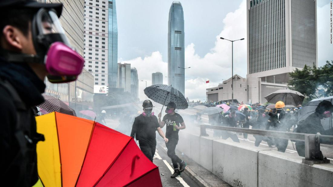 Protesters came prepared with gas masks as police fired tear gas near the government headquarters of Hong Kong on August 31.