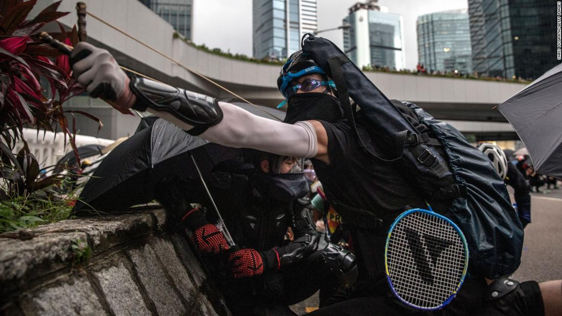 A protester uses a slingshot outside the Central Government Complex during clashes with police after an anti-government rally on Saturday, August 31 in Hong Kong. Thousands of pro-democracy protesters have defied a police ban on rallying on August 31, a day after several leading activists and lawmakers were arrested in a sweeping crackdown.