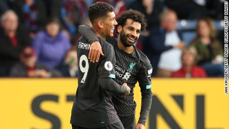 Roberto Firmino celebrates his goal with teammate Mohamed Salah.