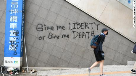 Graffiti on a wall in Tung Chung, where protesters fled after disrupting transport to and from Hong Kong airport.