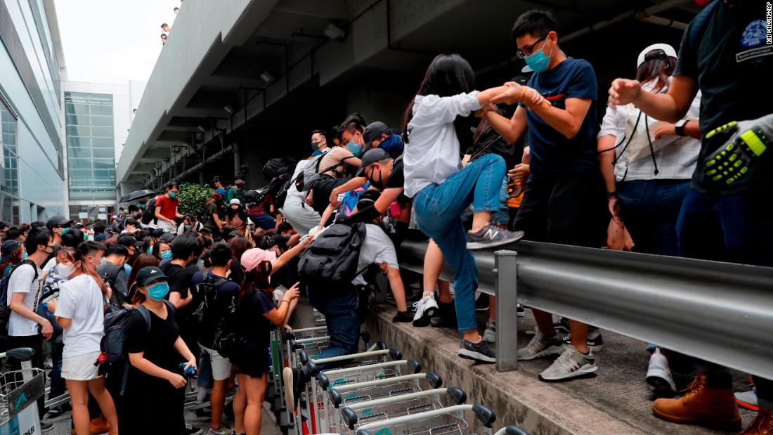 Pro-democracy protestors leave after riot police arrive outside the airport in Hong Kong on September 1.