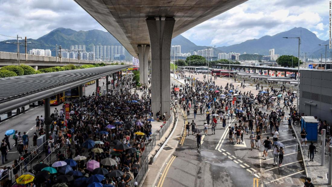 Protesters gather in the bus terminal at Hong Kong International Airport on Sunday, September 1. Hundreds of Hong Kong pro-democracy activists attempted to block transport routes to the city's airport.