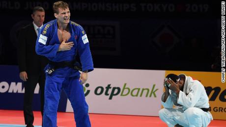 Matthias Casse celebrates winning the semi-final fight against Mollaei.