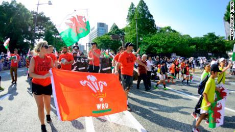 Welsh flags are carried through Kitakyushu.