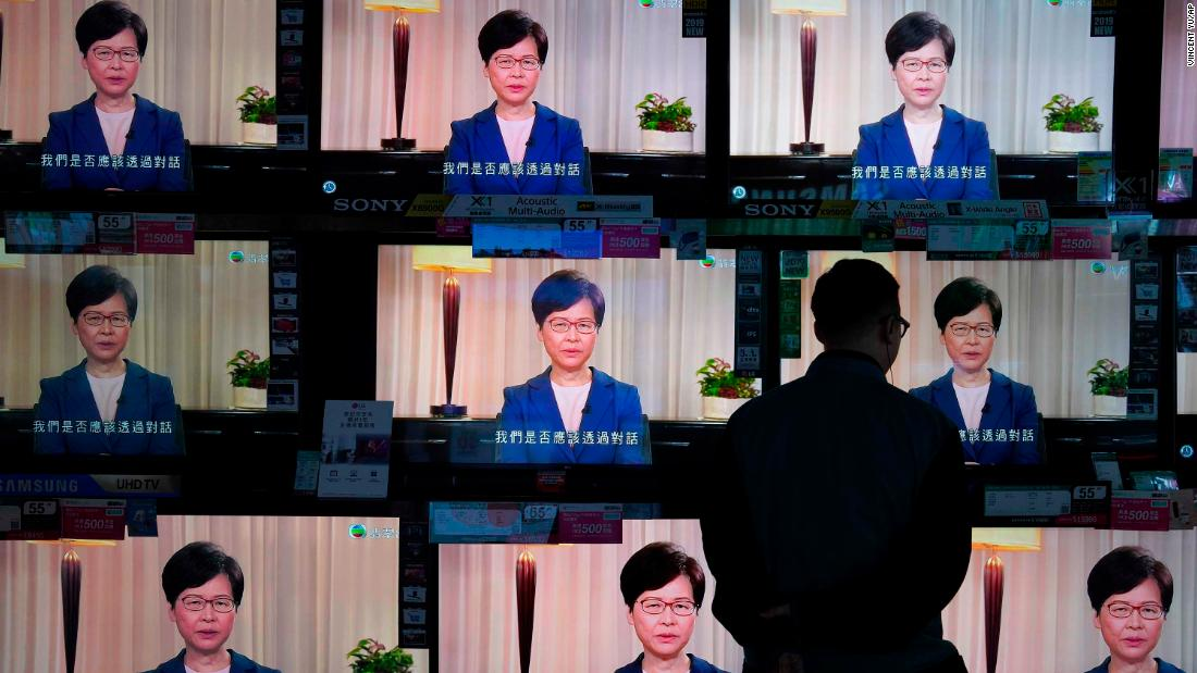 A man watches televisions at a store in Hong Kong as Chief Executive Carrie Lam announces the withdrawal of the extradition bill on Wednesday, settembre 4.