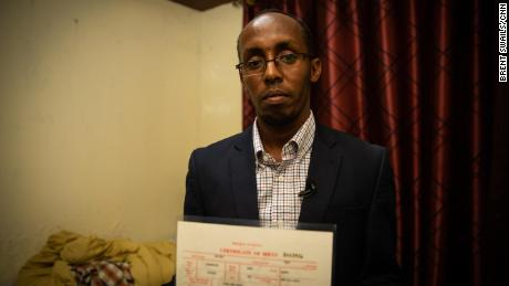Omar Sharif holds his Kenyan birth certificate. He's never set foot in Somalia but it took him only a few minutes to register as a Somali refugee.