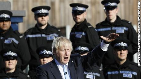 Boris Johnson makes a speech flanked by police cadets in West Yorkshire Thursday.