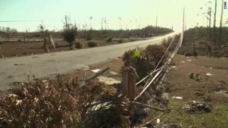 Downed power lines lie along the road into town.
