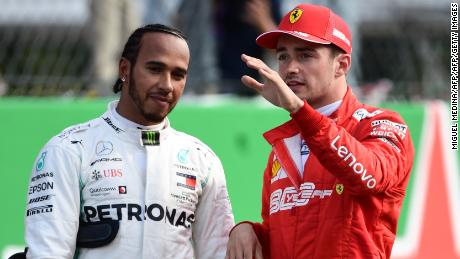 Charles Leclerc speaks with Lewis Hamilton during qualifying