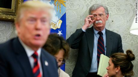 US President Donald Trump speaks as National security advisor John Bolton listens during a meeting in May 2018 in Washington DC. Democrats want to hear from Bolton in their impeachment inquiry but he has thus far refused to show.