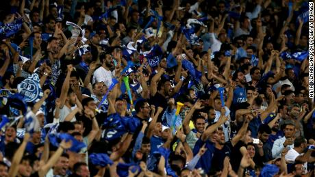 Iranian fans cheer for their team during the AFC Champions League football match Al-Sadd vs Esteghlal FC.